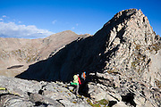 Rory Cowie and Danielle Perrot hike up the SE Ridge of Mount Bierstadt in the Mount Evans Wilderness, Rocky Mountains Front Range, Colorado.