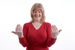 Woman with a hearing impairment using sign language,