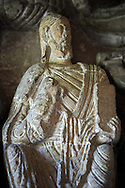 """Early Anglo Saxon sulpture of the Christ now part of the south porch of Malmesbury Abbey, Wiltshire, England. The apostles, apart from Peter who holds a crude key, have no distinguishing feature to allow identification. Some are holding books, none have halos and some hold their heads at awkward angles. These three styles are typical of Anglo Saxon art. The two panels are 10 ft long and 4ft 6"""" high are date from the original Ango Saxon church of 705. They were probablbly built into the proch during the Norman rebuilding. The style of these sculptures is of the Roman Byzantine style and were probably sculpted by masions from Gaul.  Malmesbury Abbey, Wiltshire, England .<br /> <br /> Visit our MEDIEVAL PHOTO COLLECTIONS for more   photos  to download or buy as prints https://funkystock.photoshelter.com/gallery-collection/Medieval-Middle-Ages-Historic-Places-Arcaeological-Sites-Pictures-Images-of/C0000B5ZA54_WD0s"""