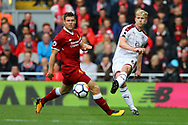 Ben Mee of Burnley passes the ball under pressure from James Milner of Liverpool. Premier League match, Liverpool v Burnley at the Anfield stadium in Liverpool, Merseyside on Saturday 16th September 2017.<br /> pic by Chris Stading, Andrew Orchard sports photography.