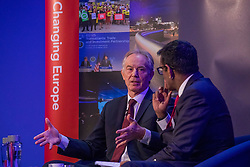 © Licensed to London News Pictures. 29/03/2018. London, UK. Former Prime Minister Tony Blair (L) speaks at 'The UK in a Changing Europe' conference in London on the first anniversary of the triggering of Article 50. Photo credit: Rob Pinney/LNP