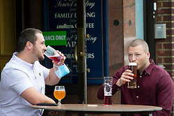 ©Licensed to London News Pictures 04/07/2020     <br /> Petts Wood, UK. Friends enjoying a drink at The Sovereign of the Seas pub in Petts Wood, South East London. England's pubs pour their first pints today after three months closed due to coronavirus Lockdown. Photo credit: Grant Falvey/LNP