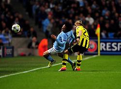 Manchester City's David Silva is fouled by Borussia Dortmund's Marcel Schmelzer - Photo mandatory by-line: Joe Meredith/JMP  - Tel: Mobile:07966 386802 03/10/2012 - Manchester City v Borussia Dortmund - SPORT - FOOTBALL - Champions League -  Manchester   - Etihad Stadium -