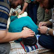 August 09, 2012 - Marea, Aleppo, Syria: Family members and friends mourn the death of Housin Al Ali, a 28 year old Free Syria Army fighter killed in combat in Alepo's Salehedine neighborhood...The Syrian army and the FSA have in the past week exchanged heavy fire in a battle for the control of Syria's economic capital, Aleppo. (Paulo Nunes dos Santos/Polaris)