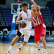 Anadolu Efes's Stratos Perperoglou (L) and Olympiacos's Matt Lojeski (R) during their Gloria Cup Basketball Tournament match Anadolu Efes between Olympiacos at Ulker Sports Arena in istanbul Turkey on Tuesday 23 September 2014. Photo by Aykut AKICI/TURKPIX