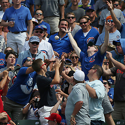 July 21, 2017 - Chicago, IL, USA - Fans reach for a foul ball in the sixth inning of a game between the Chicago Cubs and St. Louis Cardinals on Friday, July 21, 2017 at Wrigley Field in Chicago, Ill. (Credit Image: © John J. Kim/TNS via ZUMA Wire)