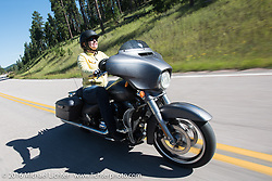Harley-Davidson employee Leah Whaley riding a full dresser on the Harley-Davidson Angels Ride to benefit the Nature Conservancy during the annual Sturgis Black Hills Motorcycle Rally.  SD, USA.  August 12, 2016.  Photography ©2016 Michael Lichter.