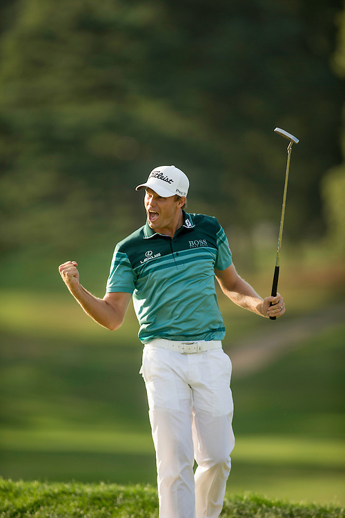 FARMINGDALE, NY - AUGUST 26:  Nick Watney reacts to his final putt to win the 2012 Barclays at the Black Course at Bethpage State Park in Farmingale, New York on August 26, 2012. (Photograph ©2012 Darren Carroll) *** Local Caption *** Nick Watney