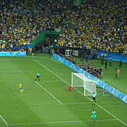 Football - Olympics: Day 15  Marquinhos #4 of Brazil scores from the penalty spot during the penalty shoot out beating Timo Horn #1 of Germany during the Brazil Vs Germany Men's Football Gold Medal Match at Maracana on August 20, 2016 in Rio de Janeiro, Brazil. (Photo by Tim Clayton/Corbis via Getty Images)