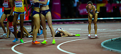 London, 2017 August 07. Laura Muir, Great Britain, lies exhausted on the ground after missing out on bronze in the women's 1,500m final on day four of the IAAF London 2017 world Championships at the London Stadium. © Paul Davey.