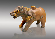 Hittite Terra cotta lion shaped ritual vessel - 16th century BC - Hattusa ( Bogazkoy ) - Museum of Anatolian Civilisations, Ankara, Turkey . Against gray background .<br /> <br /> If you prefer to buy from our ALAMY STOCK LIBRARY page at https://www.alamy.com/portfolio/paul-williams-funkystock/hittite-art-antiquities.html  - Type Hattusa into the LOWER SEARCH WITHIN GALLERY box. Refine search by adding background colour, place, museum etc<br /> <br /> Visit our HITTITE PHOTO COLLECTIONS for more photos to download or buy as wall art prints https://funkystock.photoshelter.com/gallery-collection/The-Hittites-Art-Artefacts-Antiquities-Historic-Sites-Pictures-Images-of/C0000NUBSMhSc3Oo