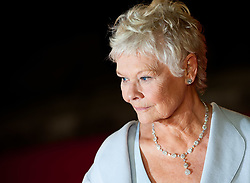 Dame Judi Dench attending the premiere of Skyfall, at the Royal Albert Hall in west London.