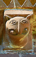 Norman Romanesque exterior corbel no 29  -  sculpture of.a creature with a rounded head, pointed ears and a beaked nose. In its huge mouth it is biting on a rod . The Norman Romanesque Church of St Mary and St David, Kilpeck Herefordshire, England. Built around 1140 .<br /> <br /> Visit our MEDIEVAL PHOTO COLLECTIONS for more   photos  to download or buy as prints https://funkystock.photoshelter.com/gallery-collection/Medieval-Middle-Ages-Historic-Places-Arcaeological-Sites-Pictures-Images-of/C0000B5ZA54_WD0s