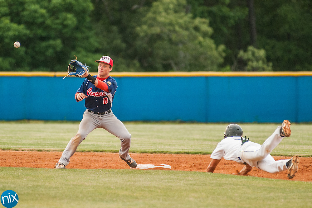 Concord Post 51's Garrett Hurlocker waits on the throw as Mooresville Post 66 Seth Hartings steals second Monday night at Lake Norman High School. Concord won the game 6-5.