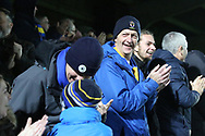 AFC Wimbledon fans celebrating during the EFL Sky Bet League 1 match between AFC Wimbledon and Southend United at the Cherry Red Records Stadium, Kingston, England on 24 November 2018.
