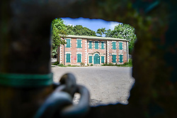 A view through the locked gates of Imber Court in Imber village on Salisbury Plain, Wiltshire, where residents were evicted in 1943 to provide an exercise area for US troops preparing to invade Europe. Roads through the MoD controlled village are now open and will close again on Monday August 22.