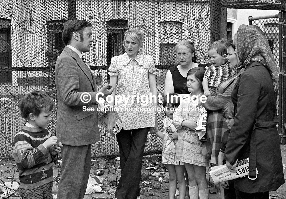 Robert Cooper, candidate, Alliance Party of N Ireland, West Belfast, canvassing along the Peace Line which separated the Protestant and Roman Catholic communities in that part of the city. Picture taken during campaigning in the Assembly Election. 197306000445d.<br /> <br /> Copyright Image from Victor Patterson, Belfast, UK<br /> <br /> t: +44 28 9066 1296 (from Rep of Ireland 048 9066 1296)<br /> m: +44 7802 353836<br /> e: victorpattersonbelfast@gmail.com<br /> <br /> www.images4media.com<br /> <br /> Please see my full Terms and Conditions of Use at https://www.images4media.com/p/terms-conditions - it is IMPORTANT that you familiarise yourself with them.<br /> <br /> Images used online incur an additional cost. This cost should be agreed in writing in advance. Online images must be visibly watermarked i.e. © Victor Patterson or that of the named photographer within the body of the image. The original metadata must not be deleted from images used online.<br /> <br /> This image is only available for the use of the download recipient i.e. television station, newspaper, magazine, book publisher, etc, and must not be passed on to a third party. It is also downloaded on condition that each and every usage is notified within 7 days to victorpattersonbelfast@gmail.com.<br /> <br /> The right of Victor Patterson (or the named photographer) to be identified as the author is asserted in accordance with The Copyright Designs And Patents Act (1988). All moral rights are asserted.