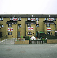 Terraced houses in Birkenhead, on the river Mersey, decorated with St. George's flags during the 2006 football World Cup. The Mersey is a river in north west England which stretches for 70 miles (112 km) from Stockport, Greater Manchester, ending at Liverpool Bay, Merseyside. For centuries, it formed part of the ancient county divide between Lancashire and Cheshire.