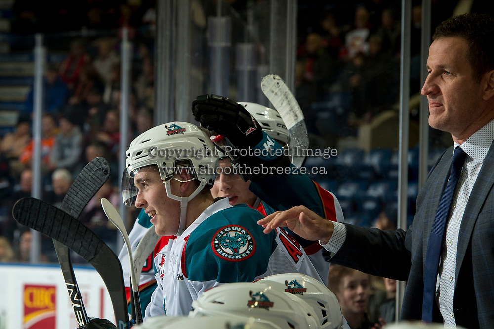 KELOWNA, CANADA - FEBRUARY 8:  Kelowna Rockets' head coach Adam Foote congratulates Cayde Augustine #5 of the Kelowna Rockets on scoring his first WHL goal against the Prince George Cougars on February 8, 2019 at Prospera Place in Kelowna, British Columbia, Canada.  (Photo by Marissa Baecker/Shoot the Breeze)