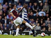 Photo: Olly Greenwood.<br />West Ham United v Reading. The Barclays Premiership. 01/10/2006. West Ham's Carlos Teves tries to get round Reading's Ibrahima Sonko