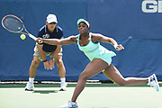 SLOANE STEPHENS hits a service return during her semifinal doubles match with partner Eugenie Bouchard at the Citi Open at the Rock Creek Park Tennis Center in Washington, D.C.