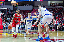 NORMAL, IL - February 22: Ricky Torres brings the ball to the lane defended by Garrett Sturtz during a college basketball game between the ISU Redbirds and the Drake Bulldogs on February 22 2020 at Redbird Arena in Normal, IL. (Photo by Alan Look)