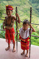 Ifugao Tribe Indigenous Children Philippines - In addition to their famous UNESCO world heritage rice terraces, the Ifugao are known for their rich oral traditions. The Ifugao tribe name means earth people. It can also mean from the hill. The Ifugao build their thatched huts elevated with wooden posts. These houses are known as fales.The ladder is removed so strangers or animals cannot enter the fale. Highland tribal peoples inhabit the six provinces of the Cordilleras in the Philippines. Igorot is the collective name of these ethnic groups who inhabit these areas.