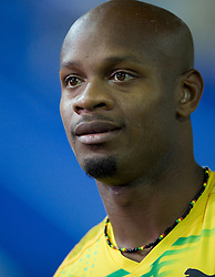 Asafa Powell of Jamaica celebrates winning the gold medal in the men's 4x100 Metres Relay Final during day eight of the 12th IAAF World Athletics Championships at the Olympic Stadium on August 22, 2009 in Berlin, Germany. (Photo by Vid Ponikvar / Sportida)