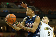 Keith Frazier (2) of Dallas Kimball drives to the basket against San Antonio Northside Brennan during the UIL Conference 4A semifinals at the Frank Erwin Center in Austin on Thursday, March 7, 2013. (Cooper Neill/The Dallas Morning News)