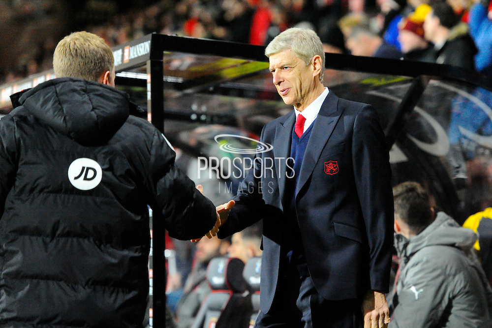 Arsenal manager Arsene Wenger shakes hands with AFC Bournemouth manager Eddie Howe before the Premier League match between Bournemouth and Arsenal at the Vitality Stadium, Bournemouth, England on 3 January 2017. Photo by Graham Hunt.