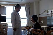 Makoto Hirakata, vice-president of Aiwa Hospice talks to his patient during the round check on November 16th, 2019 at Aiwa Hospice in Nagano, Japan.
