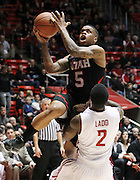 Utah guard Kareem Storey (5) is fouled by Washington State guard Mike Ladd (2) as he attempts to score during the first half of an NCAA college basketball game in Salt Lake City, Thursday, Jan. 5, 2012. (AP Photo/Colin E Braley)