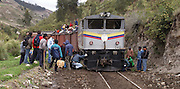 Riobamba, Ecuador - Tuesday, Dec 24 2002: Passengers on the Riobamba to Devil's Nose train watch the train crew attempt to put the train back on the rails following an earlier minor landslide.  (Photo by Peter Horrell / http://www.peterhorrell.com)
