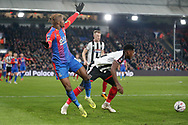 Crystal Palace forward Wilfried Zaha (11) battles for possession with Grimsby Town midfielder Mitch Rose (8) during the The FA Cup 3rd round match between Crystal Palace and Grimsby Town FC at Selhurst Park, London, England on 5 January 2019.