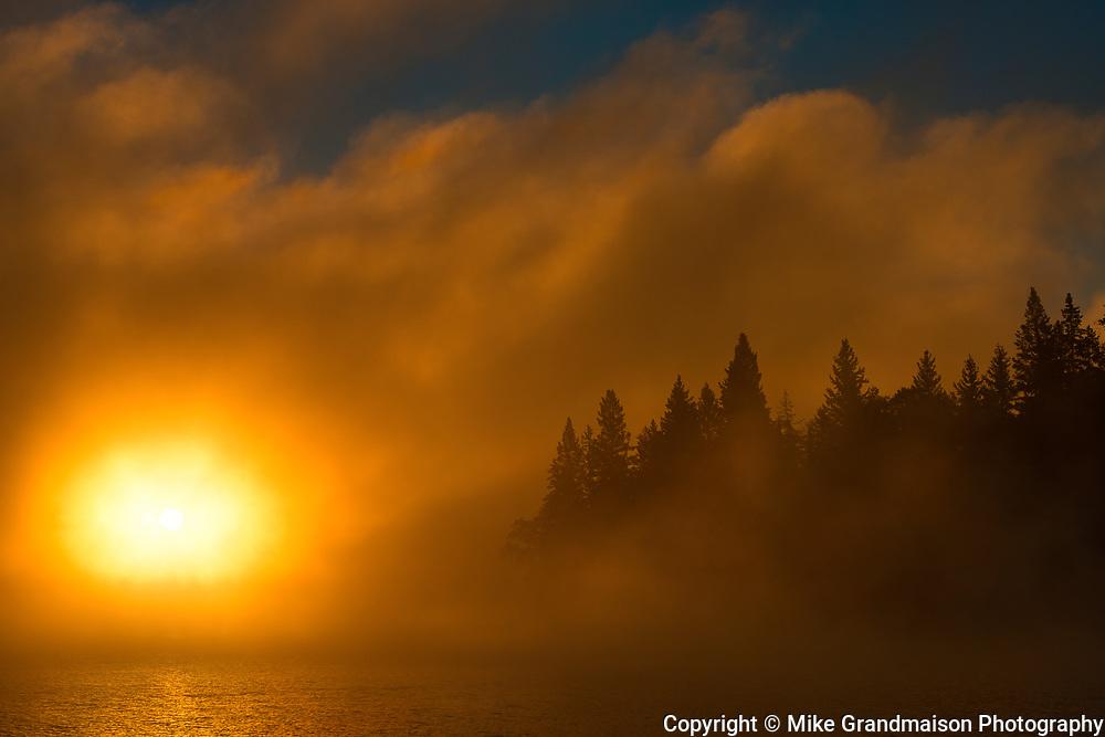Fog at sunrise over Caddy Lake<br />Whiteshell Provincial Park<br />Manitoba<br />Canada