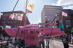 © Licensed to London News Pictures. 15/07/2019; Bristol, UK. Extinction Rebellion Summer Uprising 2019. Extinction Rebellion start their week of action by occupying Bristol Bridge in the city centre and traffic has to be diverted. Extinction Rebellion are holding a five-day 'occupation' of Bristol. As part of a country-wide rebellion called Summer Uprising, followers will be holding protests in five cities across the UK including Bristol on the theme of water, which is the group's focus for the South West. The campaign wants the Government to change its recently-set target for zero carbon emissions from 2050 to 2025.<br /> In Bristol Extinction Rebellion plan a week-long occupation of Bristol Bridge in the city centre from Monday and organisers anticipate more than 1,000 people will take part in the action. On Tuesday, they will occupy College Green in front of the city's council house before protesting outside the Ministry of Defence in Stoke Gifford on Friday Photo credit: Simon Chapman/LNP.