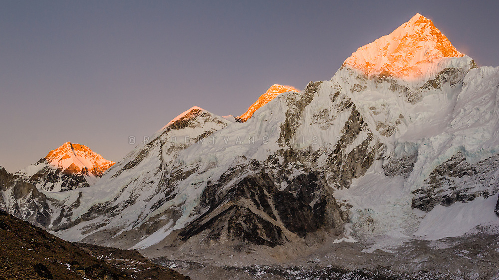 Sunset over the Nepal Himalaya with Mount Nuptse (right) and Mount Everest (second from right) visible. Photo © robertvansluis.com