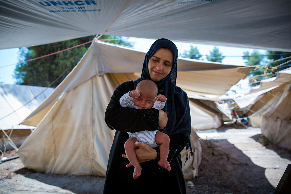 2016 July-Ritsona Refugee Camp, Ritsona, Greece. Hanan, 33, from Idlib, Syria, holding her son, Ahmed, 25 days, the youngest refugee in the camp.