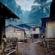 Simple wooden huts in jungle surrounding Pak Beng (Pak Beng (Pakbeng), Laos - Nov. 2008) (Image ID: 081127-0725061a)