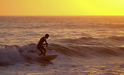 © Licensed to London News Pictures. <br /> 09/05/2016. <br /> Saltburn by the Sea, UK.  <br /> <br /> Surfer Richard Glasper rides a wave as the sun rises over the coastline at Saltburn by the Sea in North Yorkshire. After the warmest day of the year yesterday temperatures are due to drop slowly over the rest of the week.<br /> <br /> Photo credit: Ian Forsyth/LNP