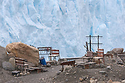 A deserted crampon fitting station at the terminal face of the Perito Moreno Glacier. The glacier is a popular hiking destination in Los Glaciares National Park, Argentina.
