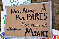 Digarded sign on the National Mall after the Climate March.