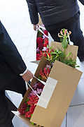 businessmen carrying a box with flowers Japan Tokyo