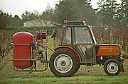 Pruning with a pneumatic compressor. Bourgueil, Loire, France