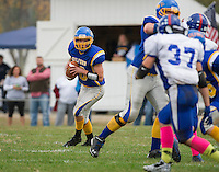 Gilford quarter back looks to pass during NHIAA Division III football with Interlakes at the Meadows Field on Saturday afternoon.  (Karen Bobotas/for the Laconia Daily Sun)