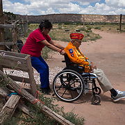 Shaylee Vandever pulls her grandfather, Navajo Code Talker Joe Vandever, Sr. up the driveway, July 12, 2019, at their home in Haystack, New Mexico. A portrait of Navajo Code Talker Joe Vandever, Sr., July 12, 2019, in his family's hogan, Haystack, New Mexico. Joe passed away in January, 2020.