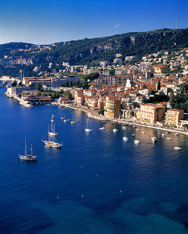 Pleasure boats moor in the small harbor at Villefranche on the Riviera in southern France.
