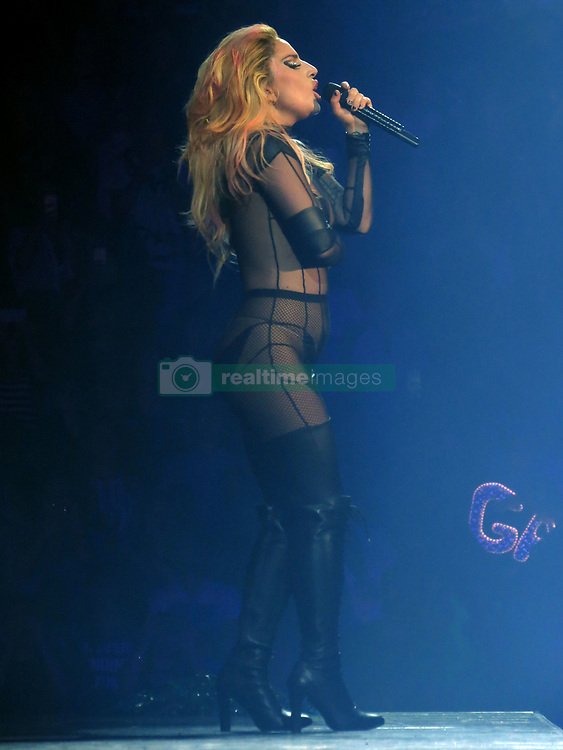 Lady Gaga wears a revealing see-through black fishnet outfit during World Tour in Vancouver. The singer had been in the city rehearsing for the tour for over a week. The concert last over an hour with lots of high energetic dancing and solo performance from Lady Gaga on the Piano and Guitar. The show was held at a sold out, packed Rogers Arena in Downtown, Vancouver. 01 Aug 2017 Pictured: Lady Gaga. Photo credit: MEGA TheMegaAgency.com +1 888 505 6342