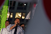 Satoru Mizushima campaigns against the Asahi newspaper with right-wing political group, Ganbare Nippon, in Hachiko Square, Shibuya, Tokyo, Japan. Friday September 12th 2014 The left-wing newspaper, Asahi Shimbun, has had to apologise publicly for printing exaggerations and falsehoods related to the Fukushima disaster and Second World War comfort women issues and faces a concerted attack on its journalists and editor by many right-wing groups.