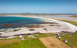 Aerial view from drone from Balgarva looking across sandy beach and estuary to Benbecula in South Uist, Outer Hebrides, Scotland, UK